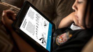 child reading e-book